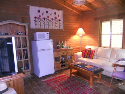 Guest area with a refrigerator, television and DVD's.